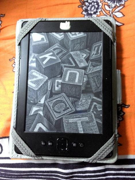 My good old Kindle, a faithful travel companion.